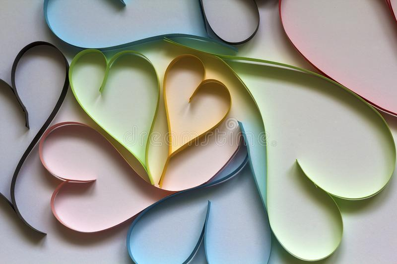 Valentine& x27;s day abstract background with cut paper colorful hear. Ts on white stock image
