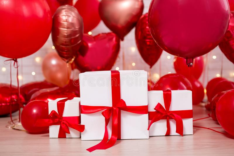Valentine`s day background - group of red balloons and gift boxes. Valentine`s day background - group of red air balloons and gift boxes stock photos
