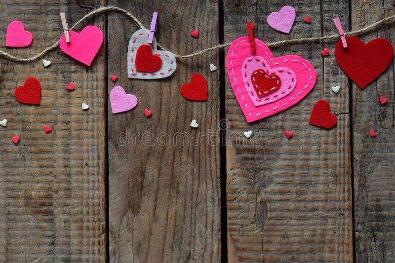 Valentine`s Day background with handmade felt hearts, clothespins. Valentine gift making, diy hobby. Romantic, love concept. Happ. Y lovers day greeting card stock photo