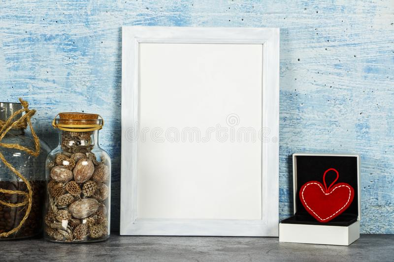 Valentine`s day background with a heart in a gift box on a blue background. Place for text. Layout for Valentine`s Day.  royalty free stock photo