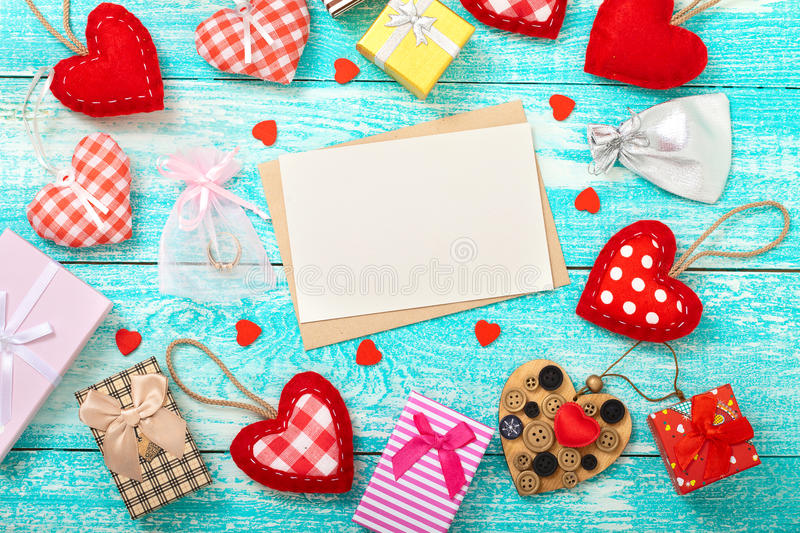 Valentine's day background with heart shapes on wooden table. royalty free stock photography