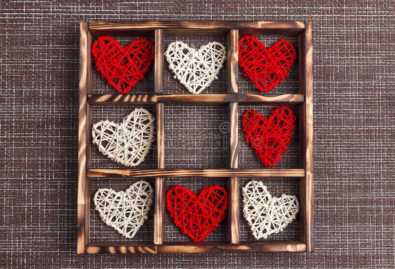 Valentine`s day background with hearts in the wooden box on sackcloth and cell copy space royalty free stock image