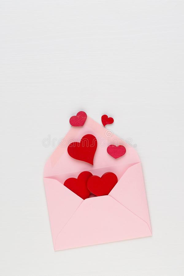 Valentine`s Day background. Letter on white background. Valentines day concept. Flat lay, top view, copy space.  royalty free stock photography