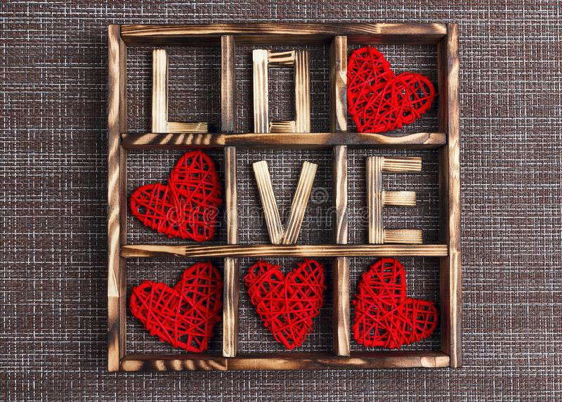 Valentine`s day background with love and hearts in the wooden box on sackcloth. Flat lay, top view royalty free stock images