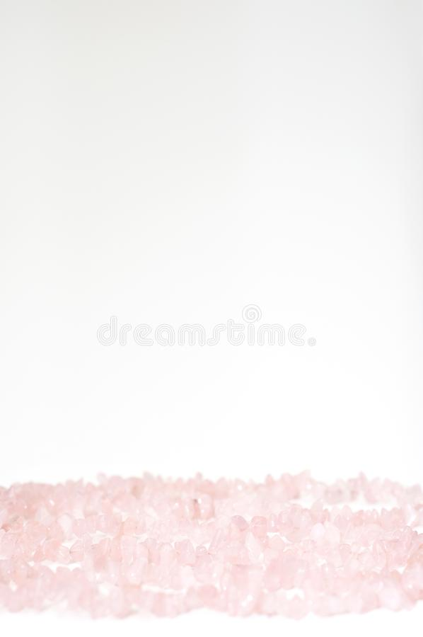 Valentine`s Day background made by healing rose quartz crystal. Necklace. Suitable to use as a Mother`s Day background or love pattern or texture stock photos
