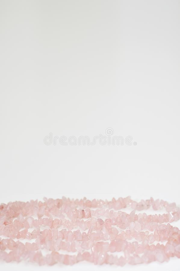 Valentine`s Day background made by healing rose quartz crystal or love stone. Valentine`s Day background made by healing rose quartz crystal necklace. Suitable stock photos