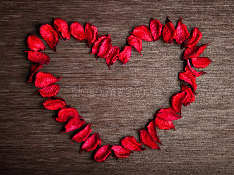 Valentine's Day background. . petals of red roses in the shape o royalty free stock images