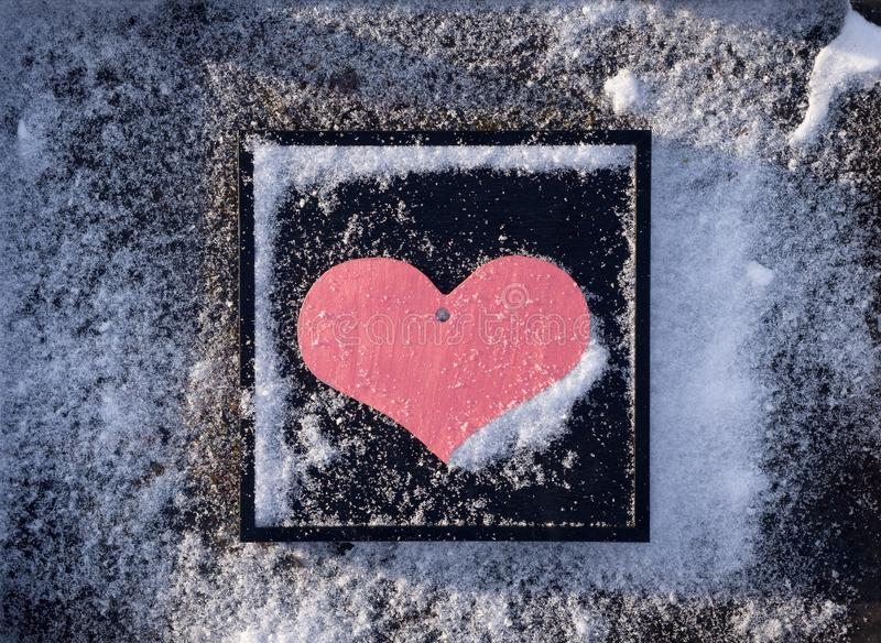 Valentine`s Day background with pink heart against textured black stock photography
