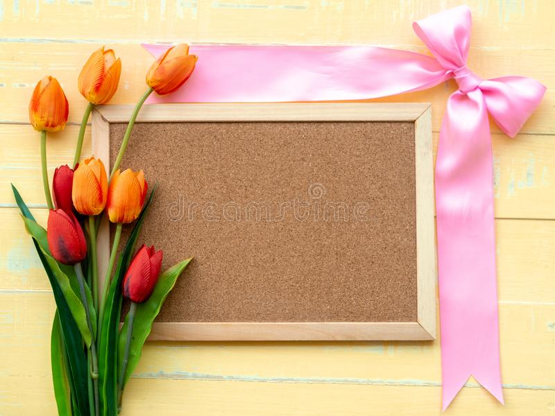Valentine`s Day Background. Pink Ribbon and Flower on Wooden background stock photography