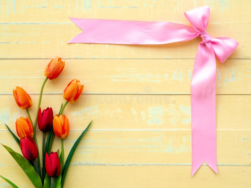 Valentine`s Day Background. Pink Ribbon and Flower on Wooden background stock images