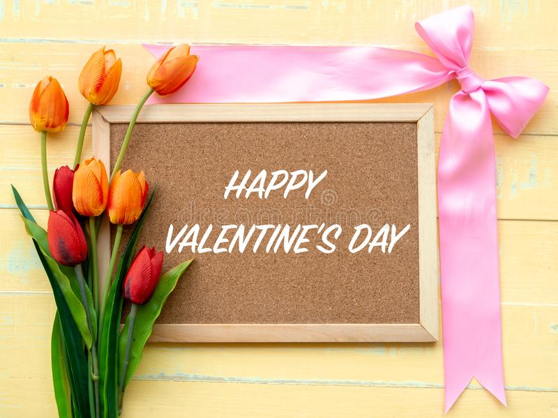 Valentine`s Day Background. Pink Ribbon and Flower on Wooden background royalty free stock photo