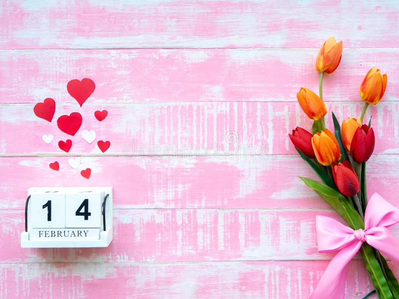 Valentine`s Day Background. Red Heart, 14 February wooden calendar, Flower on Wooden background royalty free stock images