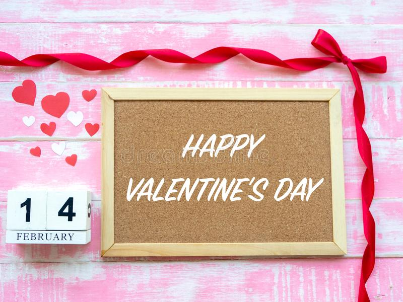 Valentine`s Day Background. Red Heart, 14 February wooden calendar, Flower on Wooden background stock images
