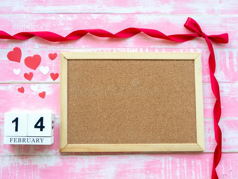 Valentine`s Day Background. Red Heart, 14 February wooden calendar, Flower on Wooden background royalty free stock image