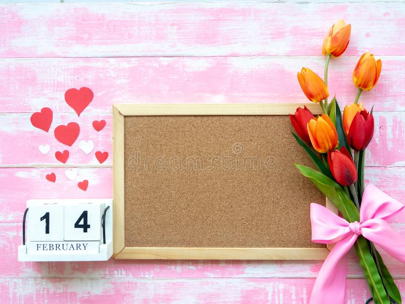 Valentine`s Day Background. Red Heart, 14 February wooden calendar, Flower on Wooden background royalty free stock photo