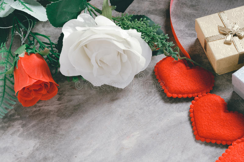 Valentine`s day background,red heart with red white rose ,ribbon. And present box decoration,selective focus royalty free stock images