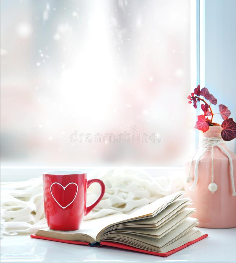 Valentine`s day background,red mug on window still stock images