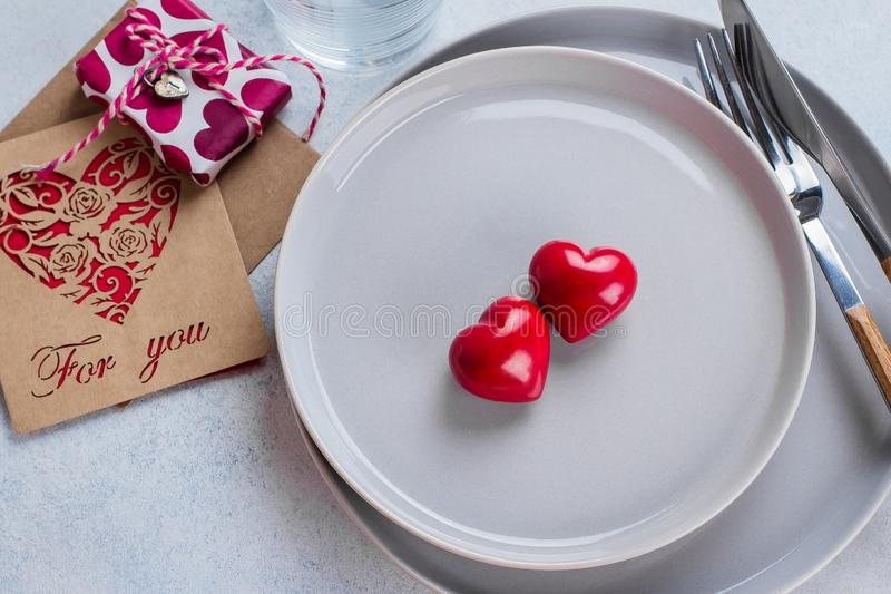 Valentine`s day background table setting with two ceramic hearts on plate. Top view, copy space stock photography