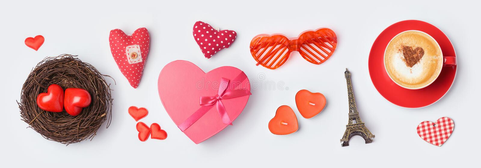 Valentine`s day banner mock up for design with gift box, coffee cup and heart shapes on white background. Top view from above. Valentine`s day banner mock up for stock photo