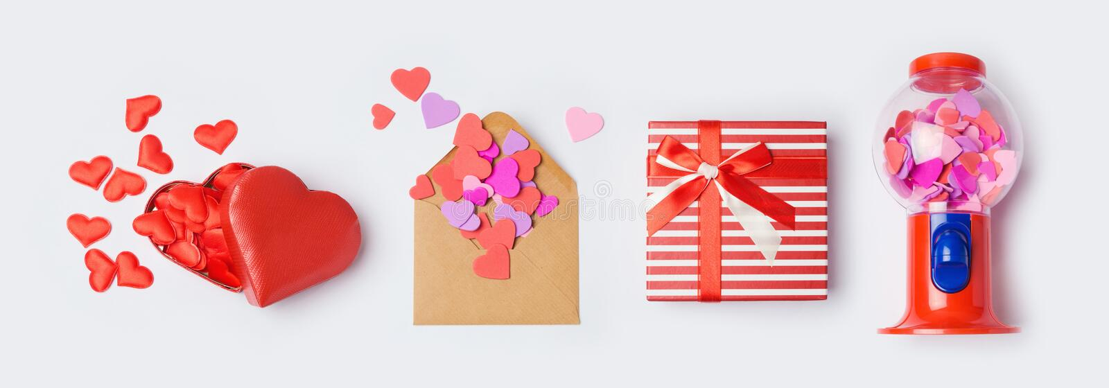 Valentine`s day banner mock up for design with gift box, envelope and heart shapes on white background. Top view from above. Valentine`s day banner mock up for royalty free stock photos