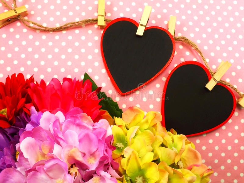 Valentine's day with beautiful flower bouqet on pink background. Heart background valentine's day with beautiful flower bouqet on pink background stock photography