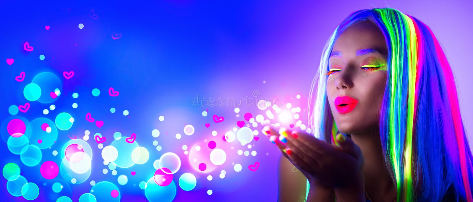 Valentine`s day. Beauty girl on disco party in neon light. Blowing Valentine neon hearts