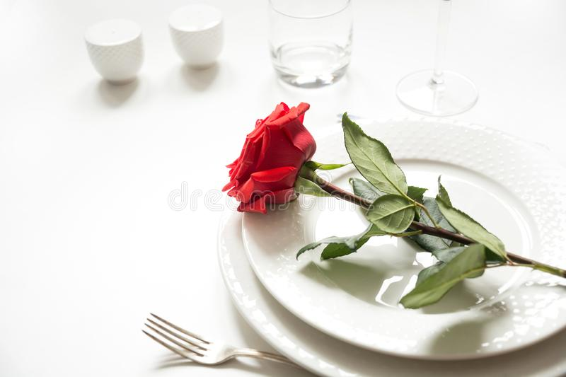 Valentine`s day or birthday romantic dinner. Romantic table setting with red rose royalty free stock photo