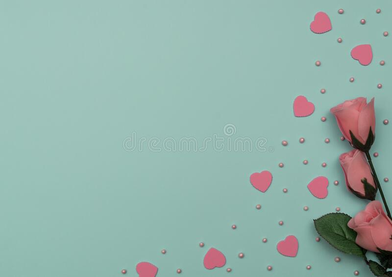 Valentine`s Day blue background with pink hearts, beads and rose. Valentine greeting card. Flat lay style stock illustration
