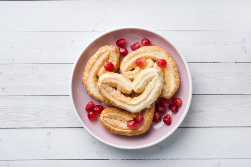 Valentine`s day Breakfast concept. Cookies hearts on a white table. copy space, flat lay stock image