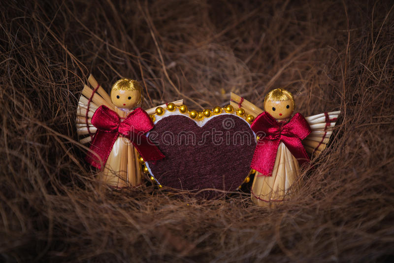 Valentine's day card with a straw. Valentine's day card with a straw in the form of hearts and angels stock images