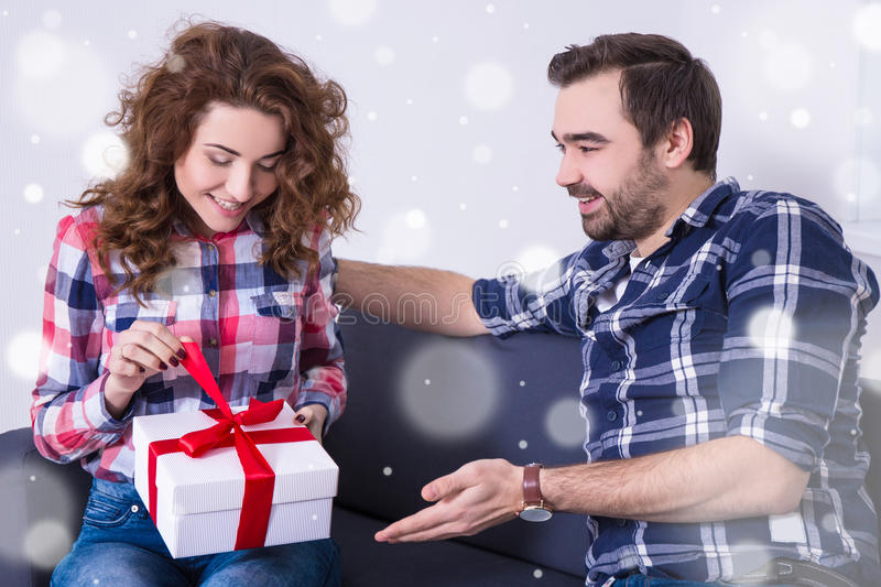 Valentine`s day or christmas concept - woman opening gift from h royalty free stock photo