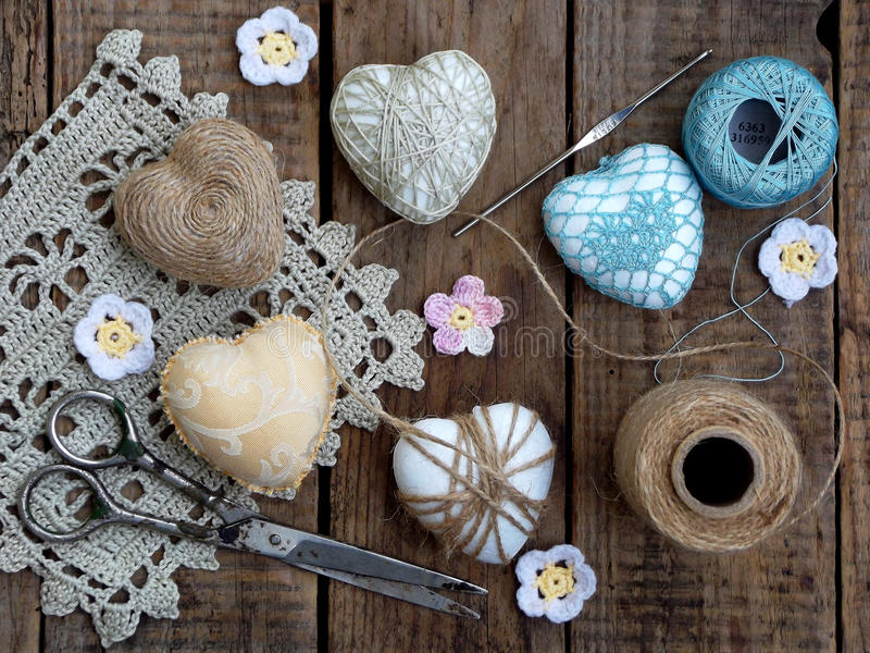Valentine`s Day concept. Composition of colourful handmade hearts on wooden background. Needlework. stock photo