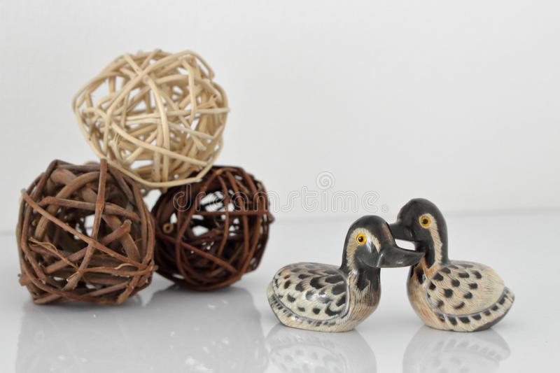 Valentine`s day concept. Couple in love, just married or honeymoon concept. Couple of stone mandarin ducks toy stock photography