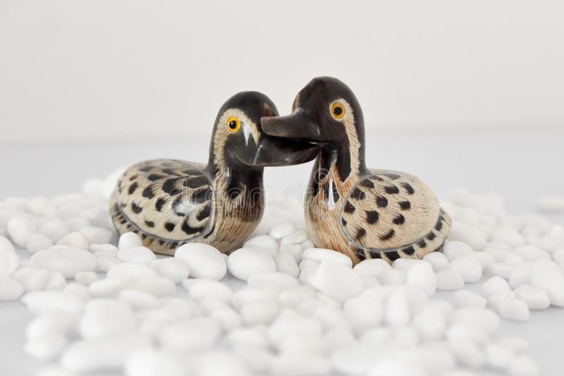 Valentine`s day concept. Couple in love, just married or honeymoon concept. Couple of stone mandarin ducks toy. royalty free stock photography