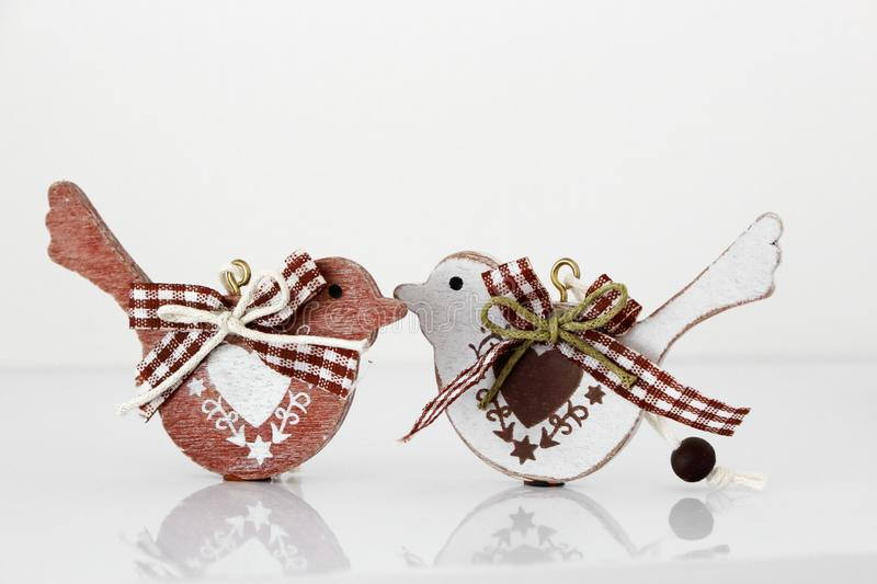 Valentine`s day concept. Couple in love, just married or honeymoon concept. Couple of wooden birds looking at each other royalty free stock photos
