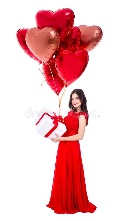 Valentine`s day concept - full length portrait of beautiful woman in red dress with gift boxes and air balloons isolated on white royalty free stock images