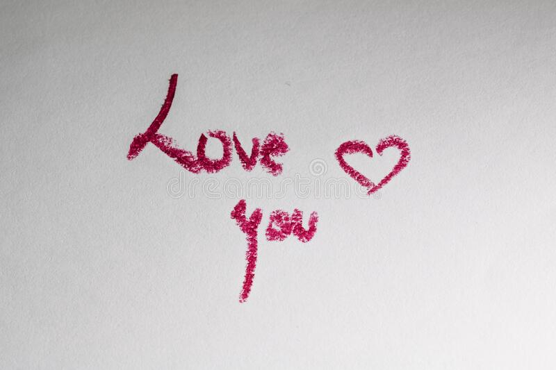 Valentine`s day concept. Lipstick kiss. Writing and drawing with lipstick. Love you stock photo