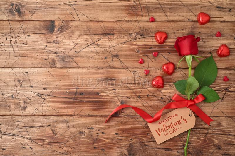 Valentine`s day concept with rose flower and heart shape chocolate royalty free stock image