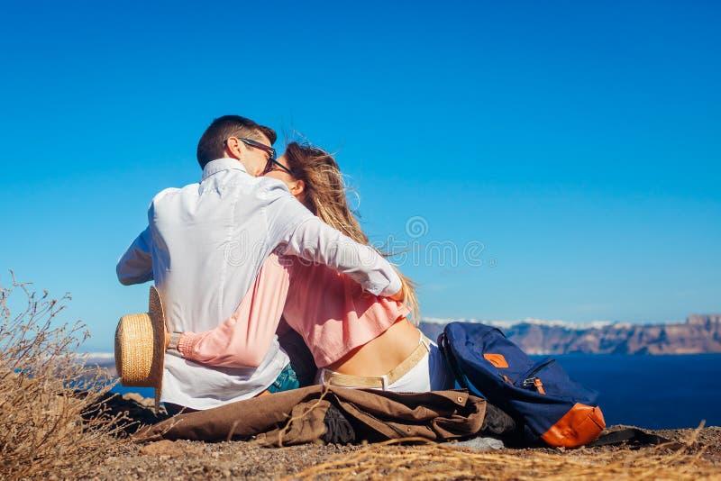 Valentine`s day. Couple in love enjoying sea landscape on honeymoon on Santorini island, Greece. Vacation and traveling. Valentine`s day. Couple in love enjoying stock image