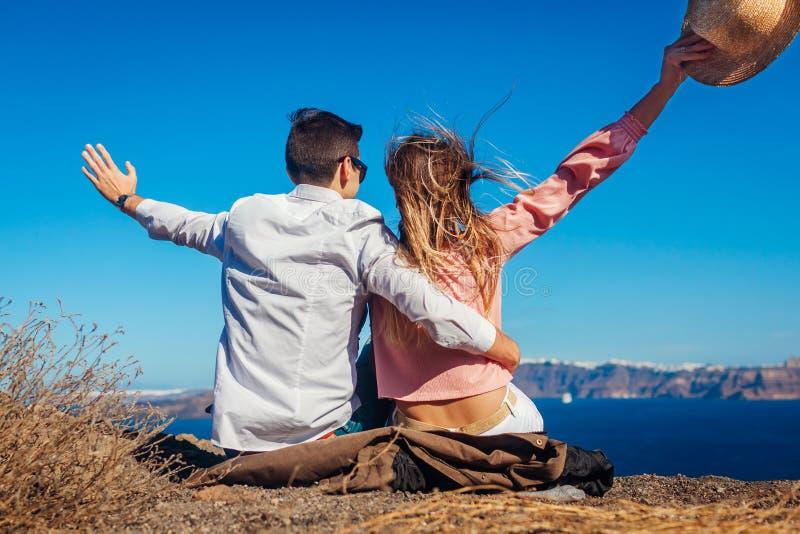 Valentine`s day. Couple in love enjoying sea landscape on honeymoon on Santorini island, Greece. Vacation and traveling. Valentine`s day. Couple in love enjoying royalty free stock photos