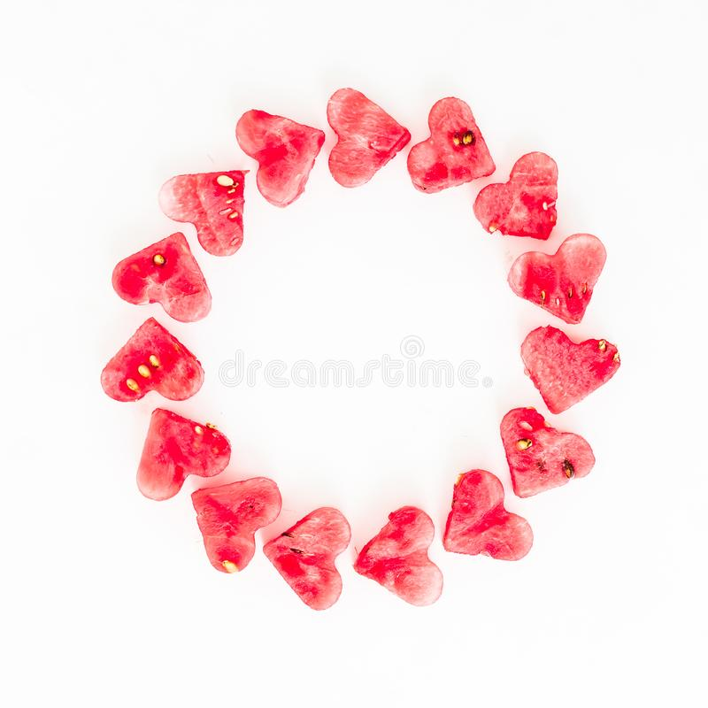 Valentine`s day frame made of watermelon slice on white background. Flat lay, top view. Frame background stock image