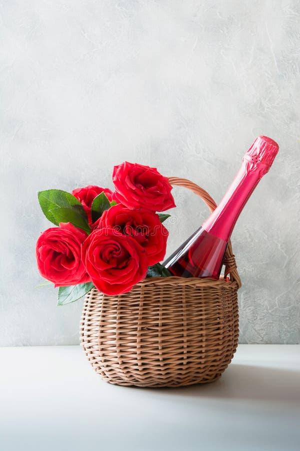 Valentine`s day gift hamper, bouquet of red roses, champagnes on white. Valentine`s day gift hamper, bouquet of red roses, champagne on white stock images