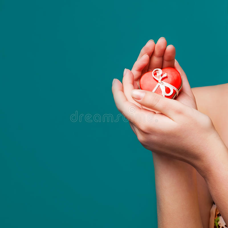 Valentine's Day gift in hands stock photos