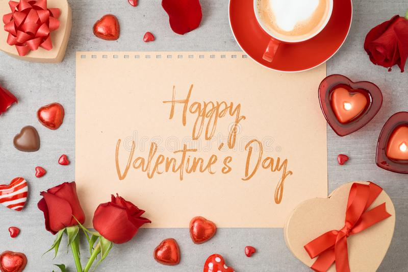 Valentine`s day greeting card with coffee cup, heart shape chocolate, candles and gift boxes stock image