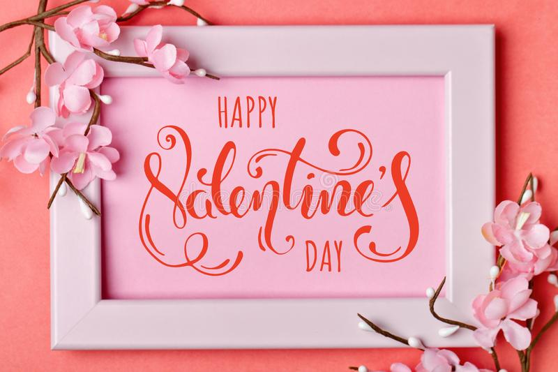 Valentine`s day. Greeting card on coral background. Selective focus. Horizontal. stock image