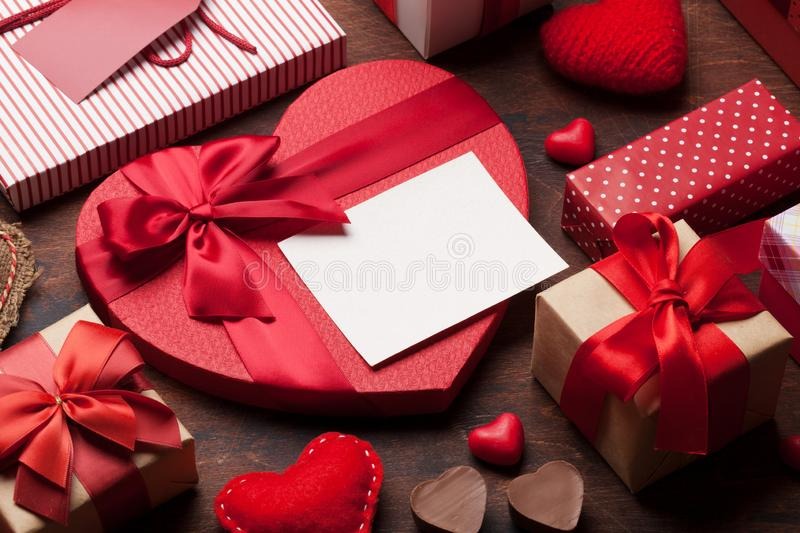 Valentine`s day greeting card. With handmaded heart toys and love gift boxes on wooden background. With space for your greetings stock photo