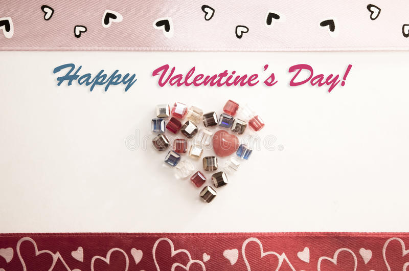 Valentine's Day Greeting Card. Happy Valentine's Day Greeting Card. Vintage and stylish Valentine Card decorated with hearts, jewels and ribbons at a light stock photos