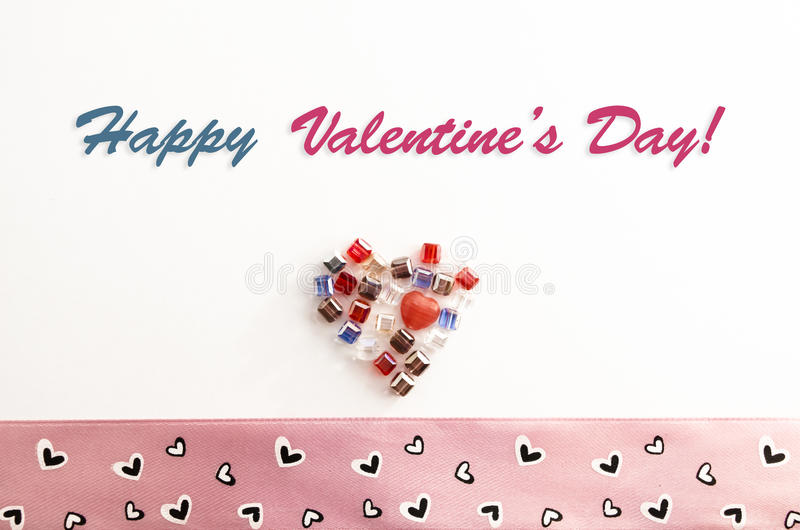 Valentine's Day Greeting Card. Happy Valentine's Day Greeting Card. Vintage and stylish Valentine Card decorated with hearts, jewels and ribbons at a light royalty free stock photography