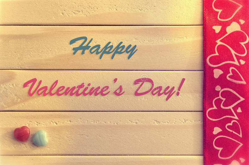Valentine's Day Greeting Card. Happy Valentine's Day Greeting Card. Vintage and stylish Valentine Card decorated with hearts, jewels and ribbons at a wooden royalty free stock images