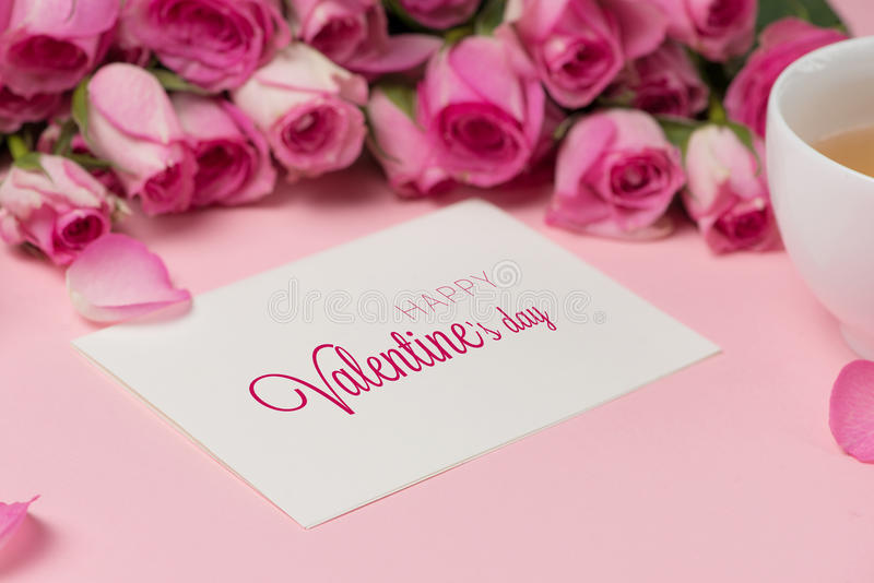 Valentine`s Day greeting card with rose flowers over wooden back royalty free stock images